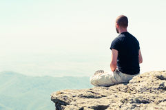 Young man relaxing on top of the mountain Royalty Free Stock Photography
