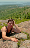Young man relaxing on the top of the mountain Stock Photos