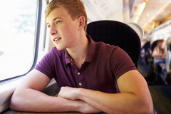 Young Man Relaxing On Train Journey Stock Image