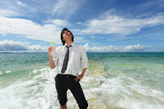 Young Man Relaxing on Tropical Beach Royalty Free Stock Photography