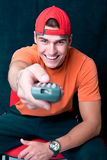Young man with a remote control Stock Photography