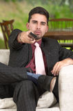 Young man with remote control Stock Image