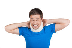 Young man removing cervical collar. Stock Photo