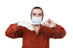 The young man removing a medical rubber glove Royalty Free Stock Images