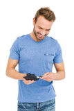 Young man removing money from his wallet Stock Photos