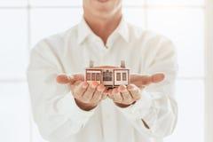 Young man rent apartment real estate agency Stock Photos