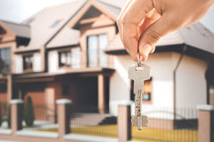 Young man rent apartment real estate agency. Young woman rent apartment real estate agency holding keys stock images