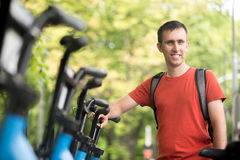 Young man renting bike Stock Images
