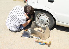 Young man repairing broken car Stock Photography