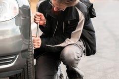 Young man repairing car Stock Photos