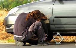 Young man repairing the car Stock Photos
