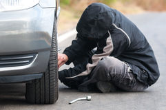 Young man repairing car outdoors Stock Photography