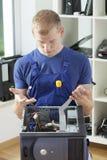 Young man repairing computer Stock Photography