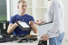 Young man repairing computer Royalty Free Stock Photo