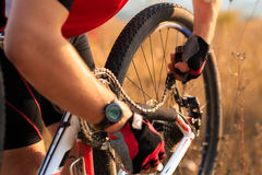 Young man repairing mountain bike in the forest Stock Photo