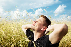 Young man rest on field Stock Image