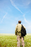 Young man rest on green field Royalty Free Stock Photo