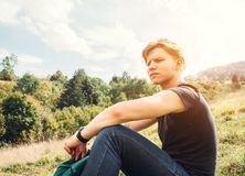Young man rest on the green meadow Royalty Free Stock Images