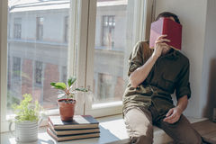 Young man rest after reading book Stock Images