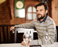 Young man in a restaurant Stock Image
