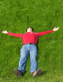Young man resting. On the grass Stock Photography