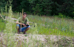 Young man resting after air rifle shooting Royalty Free Stock Photos