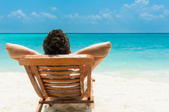 Young man resting on beach Royalty Free Stock Image