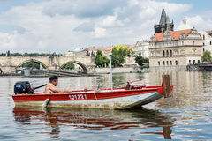 Young man resting in boat on the river Vltava near the Charles B Royalty Free Stock Images