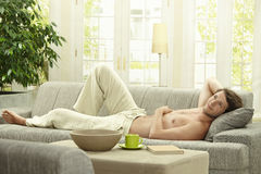Young man resting on couch Royalty Free Stock Photo