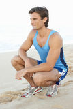 Young Man  Resting After Exercise On Beach Royalty Free Stock Photos