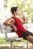 Young Man Resting After Exercise In Park Stock Image