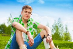 Young man resting on the grass Royalty Free Stock Images