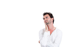 A young man resting head on hand dreaming Royalty Free Stock Image