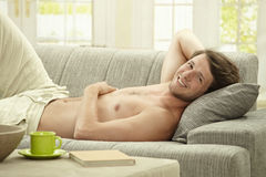 Young man resting at home Royalty Free Stock Photo
