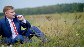 A young man resting on the meadow - wedding stock footage
