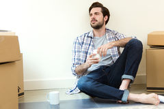 Young man resting during the move to their new home Royalty Free Stock Photos