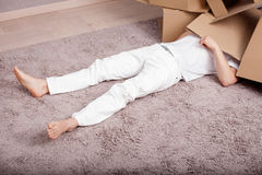 Young man is resting in process of packing Stock Images