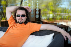 Young man resting at a resort Stock Photography