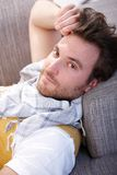 Young man resting on sofa stock photo