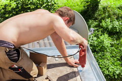 Young man restored a balcony Royalty Free Stock Photography