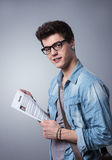 Young man with resume. Young smiling man holding his resume applying for a job stock images