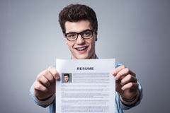 Young man with resume Stock Images