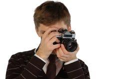 Young man with retro camera Royalty Free Stock Photos
