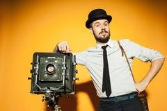 Young man with retro camera Stock Photos