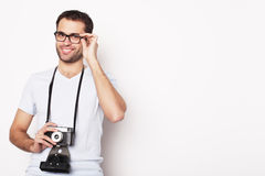 Young man with a retro camera Royalty Free Stock Photography