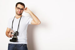 Young man with a retro camera Stock Images