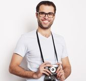 Young man with a retro camera Royalty Free Stock Photo