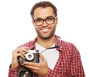 Young man with a retro camera Stock Photo
