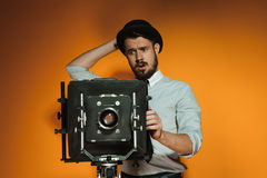 Young man with retro camera Royalty Free Stock Images