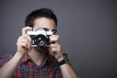 Young man with retro photo camera Royalty Free Stock Photo